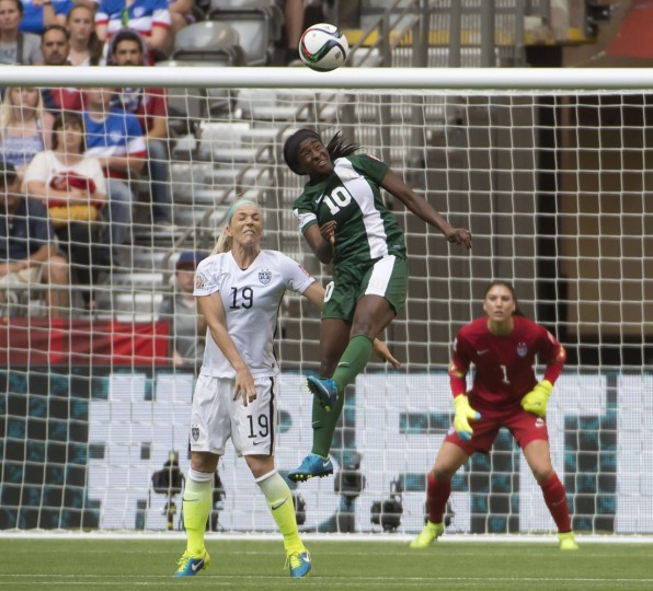 United States' Julie Johnston (19) fights for control of the ball with Nigeria's Courtney Dike (10) as United States goal keeper Hope Solo (1) looks on during the first half of a FIFA Women's World Cup soccer match, Tuesday, June 16, 2015 in Vancouver, New Brunswick, Canada. (Jonathan Hayward/The Canadian Press via AP)