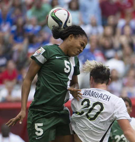 United States' Abby Wambach fights for control of the ball with Nigeria's Onome Ebi during the first half of a FIFA Women's World Cup soccer match, Tuesday, June 16, 2015 in Vancouver, New Brunswick, Canada. (Jonathan Hayward/The Canadian Press via AP)