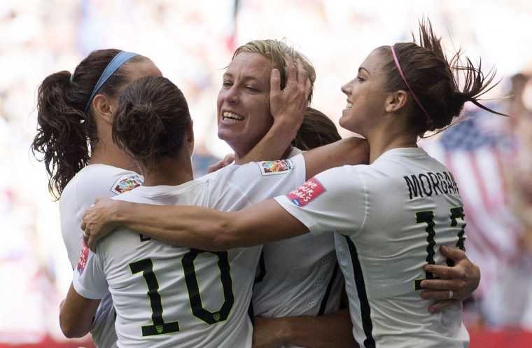 United States' Abby Wambach celebrates her goal with her teammates during the first half of a FIFA Women's World Cup soccer match against Nigeria, Tuesday, June 16, 2015 in Vancouver, New Brunswick, Canada. (Jonathan Hayward/The Canadian Press via AP)