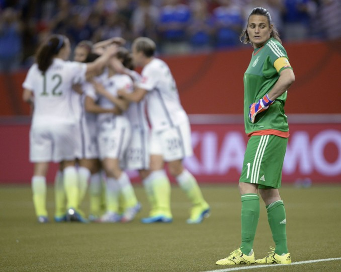 Germany keeper Nadine Angerer reacts after a U.S. goal by Kelly O'Hara during the second half of a semifinal in the Women's World Cup soccer tournament, Tuesday, June 30, 2015, in Montreal, Canada. (Ryan Remiorz/The Canadian Press via AP)