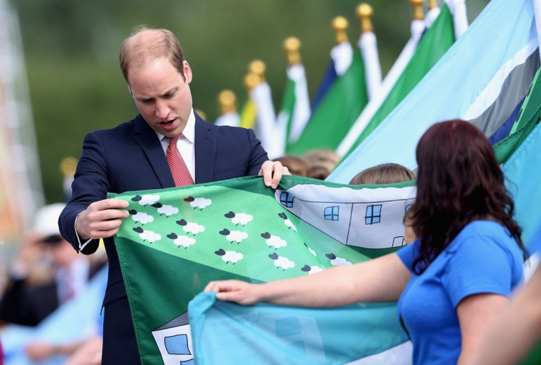 Britain's Prince William, Duke of Cambridge, views a flag made by school children from 80 schools during a service to mark the 800th anniversary of Magna Carta at Runnymede near Windsor, west of London, on June 15, 2015. Britain's Queen Elizabeth II led commemorations on the meadow in Runnymede, south England, where her distant predecessor King John sealed Magna Carta, the document that laid the foundation for parliamentary democracy in the West, on June 15, 1215. (AFP Photo/Pool / )
