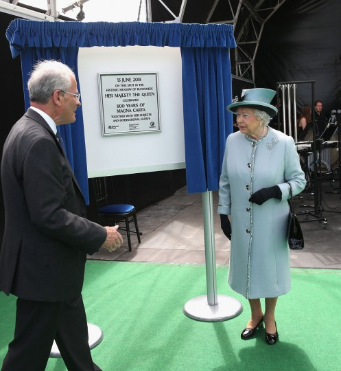 Queen Elizabeth II unveils a plaque at a Magna Carta 800th Anniversary Commemoration Event on June 15, 2015 in Runnymede, United Kingdom. Members of the Royal Family are visiting Runnymede to attend an event commemorating the 800th anniversary of Magna Carta. Magna Carta is widely recognised as one of the most significant documents in history. Its influence, as a cornerstone of fundamental liberties, is felt around the world in the constitutions and political traditions of countless nations. (Photo by Chris Jackson - WPA Pool / Getty Images)