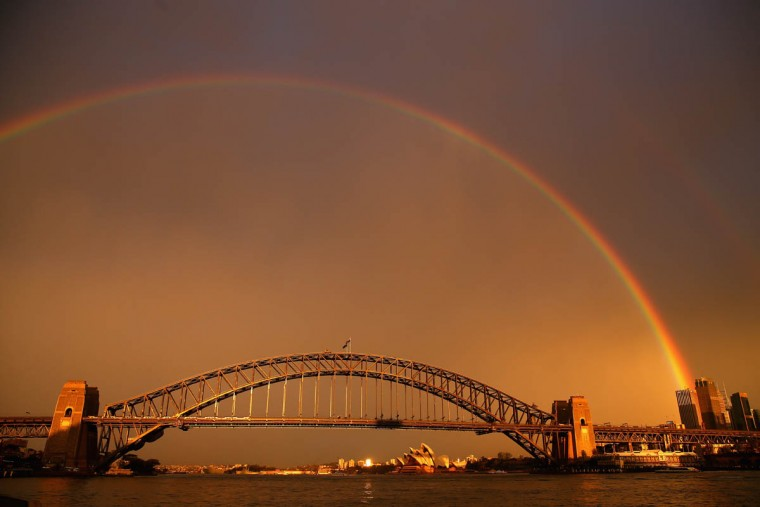 A rainbow is seen over the Sydney Harbour Bridge in Sydney, Australia. (Cameron Spencer/Getty Images)