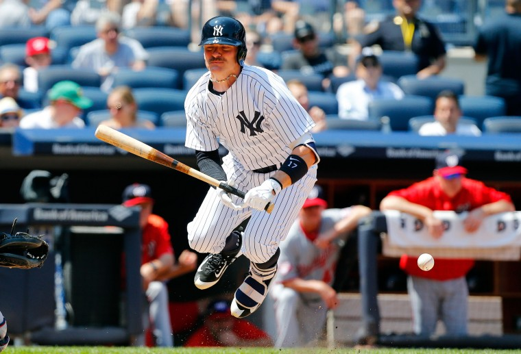 Brendan Ryan of the New York Yankees is hit by a pitch in the fifth inning against the Washington Nationals at Yankee Stadium in the Bronx borough of New York City. (Jim McIsaac/Getty Images)