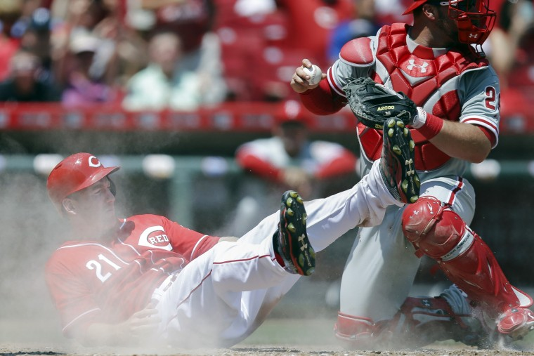 Cincinnati Reds' Todd Frazier (21) is safe at home against Philadelphia Phillies catcher Cameron Rupp in the seventh inning of their baseball game in Cincinnati. The Reds won 5-2. (John Minchillo/Associated Press)