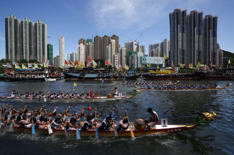 Participants compete in a dragon boat race in Hong Kong. The race is part of celebrations marking the Chinese Dragon Boat Festival, held throughout Hong Kong. (Kin Cheung/Associated Press)