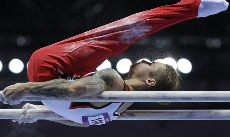 Oleg Stepko of Azerbaijan competes during final of the men's parallel bars event at the 2015 European Games in Baku, Azerbaijan. (Dmitry Lovetsky/Associated Press)