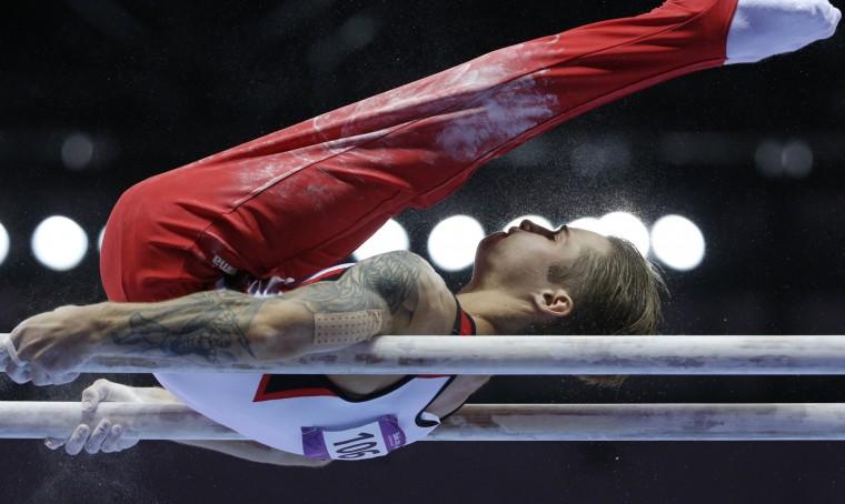 Oleg Stepko of Azerbaijan competes during final of the men's parallel bars event at the 2015 European Games in Baku, Azerbaijan. (Dmitry Lovetsky/Associated Press)