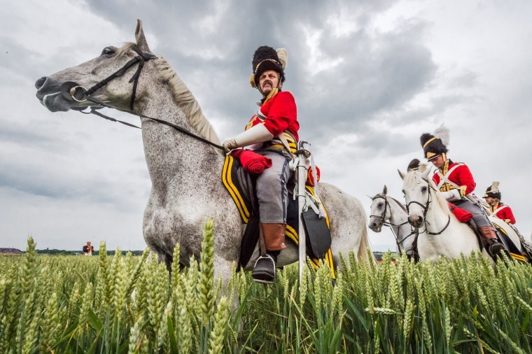 "Re-enactors on horses take their positions on the battlefield before the reconstruction of ""The Allied Counterattack"" as part of the commemoration of the bicentenary of the battle of Waterloo in Braine-l'Alleud, near Waterloo, Belgium. Over two days, 5000 re-enactors, 300 horses and 100 canons reconstruct two phases of the battle of Waterloo. (Geert Vanden Wijngaert/Associated Press)"