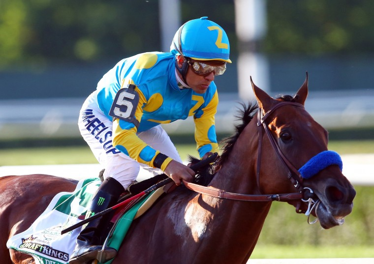 Victor Espinoza, celebrates atop American Pharoah #5, after winning the 147th running of the Belmont Stakes at Belmont Park on June 6, 2015 in Elmont, New York. With the wins American Pharoah becomes the first horse to win the Triple Crown in 37 years. (Elsa/Getty Images)
