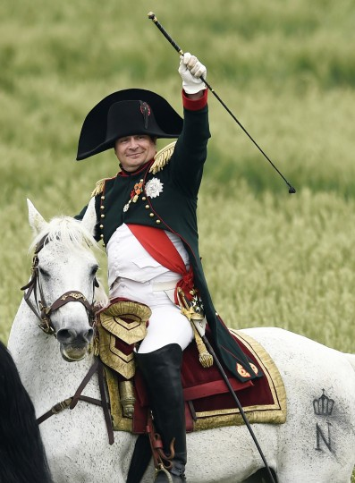 "French lawyer Franck Samson, dressed as Napoleon I, takes part in the second and last part of a re-enactement of the Battle of Waterloo, ""The Allied counterattack"", during the celebrations of the 200th anniversary of The Battle of Waterloo, in Waterloo. The battle was a pivotal moment in European history, as some 93,000 French troops led by Napoleon fought 125,000 British, German and Belgian-Dutch forces under the command of the Duke of Wellington and Field Marshal Bluecher. (John Thys/AFP-Getty Images)"