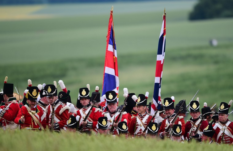 """Re-enactors take part in the second and last part of the Battle of Waterloo, """"The Allied counterattack"""", during the celebrations of the 200th anniversary of The Battle of Waterloo, in Waterloo. The battle was a pivotal moment in European history, as some 93,000 French troops led by Napoleon fought 125,000 British, German and Belgian-Dutch forces under the command of the Duke of Wellington and Field Marshal Bluecher. (Emmanuel Dunand/AFP-Getty Images)"""