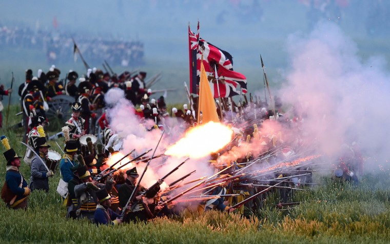 "Re-enactors take part in a re-enactement of the Battle of Waterloo, ""The French Attack"", during the celebrations of the 200th anniversary of The Battle of Waterloo, in Waterloo. The battle was a pivotal moment in European history, as some 93,000 French troops led by Napoleon fought 125,000 British, German and Belgian-Dutch forces under the Duke of Wellington and Field Marshal Bluecher. (Emmanuel Dunand/AFP-Getty Images)"