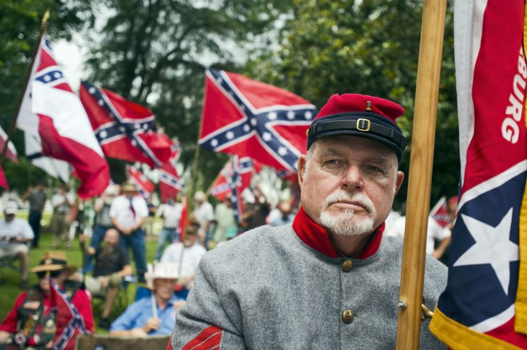 Ray Kyle holds a Confederate flag at Alabama State Capitol building during a Confederate flag rally in Montgomery, Ala. (Albert Cesare/The Montgomery Advertiser via AP)
