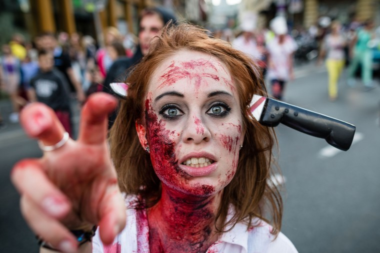 A woman walks the streets as she takes part in the Zombiewalk, an annual parade of Zombie movie enthusiasts, in Warsaw. (Wojtek Radwanski/AFP-Getty Images)