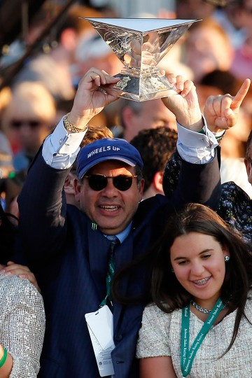 Ahmed Zayat, owner of American Pharoah #5, celebrates with the Triple Crown Trophy after winning the 147th running of the Belmont Stakes at Belmont Park on June 6, 2015 in Elmont, New York. With the win, American Pharoah becomes the first horse to win the Triple Crown in 37 years. (Rob Carr/Getty Images)
