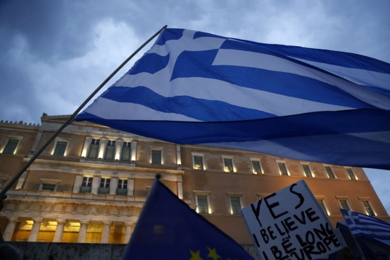 Demonstrators gather during a rally organized by supporters of the YES vote for the upcoming referendum in front of the Greek Parliament in Athens, Tuesday, June 30, 2015. (AP Photo/Petros Karadjias)