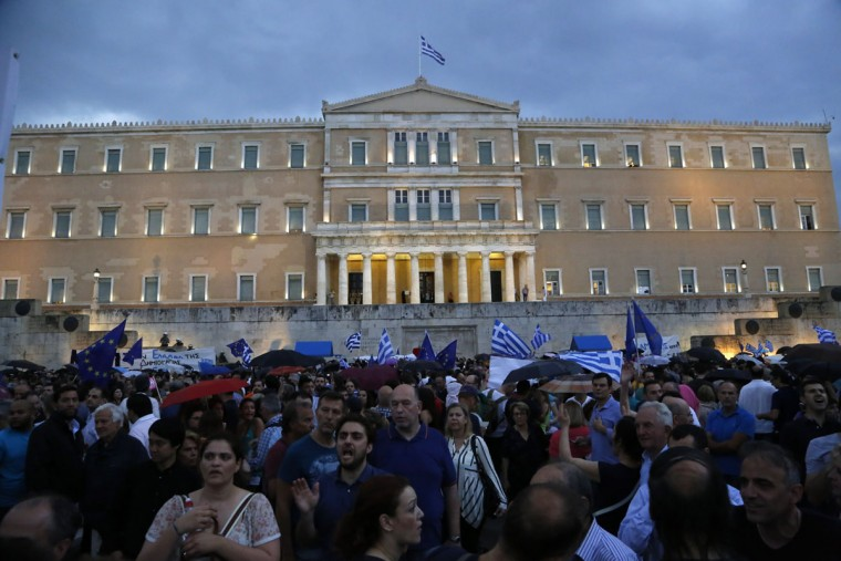 Demonstrators shout slogans during a rally organized by supporters of the YES vote to the upcoming referendum in front of the Greek Parliament in Athens, Tuesday, June 30, 2015. (AP Photo/Petros Karadjias)