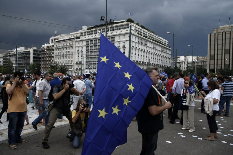 A man holds a European Union flag during a rally by supporters of the YES vote to the upcoming referendum, at Syntagma Square in Athens, Tuesday, June 30, 2015. (AP Photo/Daniel Ochoa de Olza)