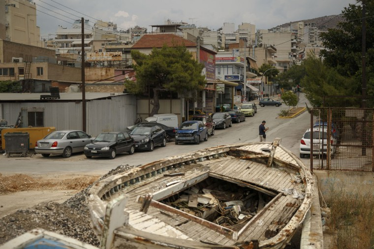 An abandoned boat rests in the streets of Perama near Athens, Tuesday, June 30, 2015. Greek Finance Minister Yanis Varoufakis confirmed that the country will not make its payment due later to the International Monetary Fund. (AP Photo/Daniel Ochoa de Olza)
