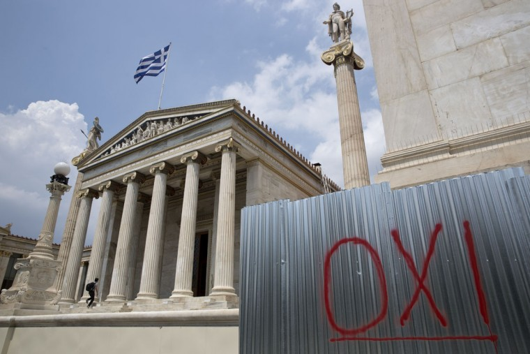 "The word ""NO"", referring to the upcoming referendum, is written in red paint outside the Athens Academy building on Tuesday, June 30, 2015. (AP Photo/Petros Giannakouris)"