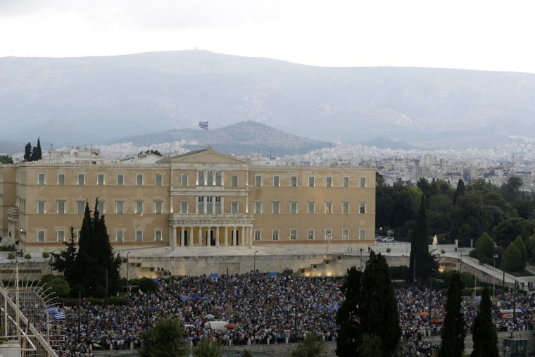 Demonstrators gather during a rally organized by supporters of the YES vote to the upcoming referendum, at Syntagma square in Athens, Tuesday, June 30, 2015. (AP Photo/Thanassis Stavrakis)