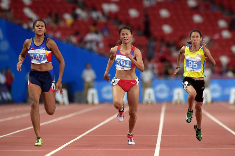 From left, Kayla Anise Richardson, of the Philippines, Tassaporn Wannaki, of Thailand, and Zaidatul Husniah Zulkifli, of Malaysia, compete in the Women's 100m Final at the SEA Games in Singapore, Tuesday, June 9, 2015.(AP Photo/Joseph Nair)