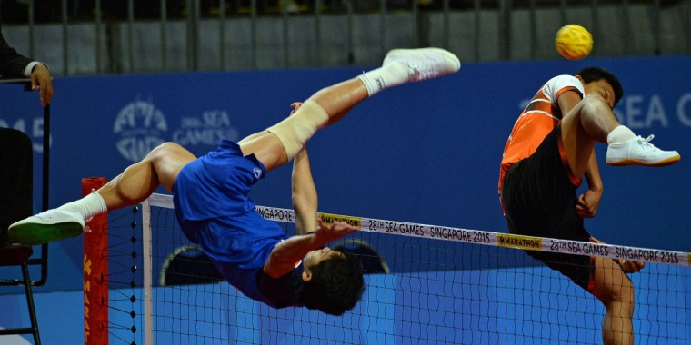 Thawisak Thongsai of Thailand kicks the ball against Malaysia during the men's team sepaktakraw preliminary round match at the 28th Southeast Asian Games (SEA Games) in Singapore on June 8, 2015. (MOHD FYROL/AFP/Getty Images)