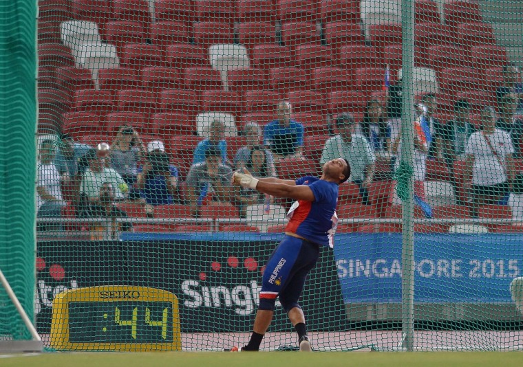 Caleb John Christian Stuart of the Philippines competes in the final of the men's hammer-throw athletics event during the 28th Southeast Asian Games (SEA Games) in Singapore on June 9, 2015. (MANAN VATSYAYANA/AFP/Getty Images)