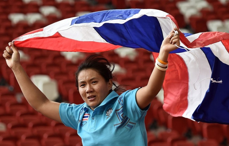 Mingkamon Koomphon of Thailand celebrates after winning the final of the women's hammer-throw athletics event during the 28th Southeast Asian Games (SEA Games) in Singapore on June 9, 2015. (MANAN VATSYAYANA/AFP/Getty Images)