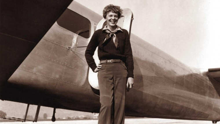 Aviator Amelia Earhart poses by her Electra plane at Burbank Airport in Burbank, Calif., on May 20, 1937. (Albert Bresnik, AP)