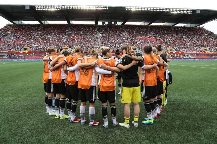 Germany players huddle together prior to kickoff during of Cote d'Ivoire during the FIFA Women's World Cup Canada 2015 Group B match between Germany and Cote d'Ivoire at Lansdowne Stadium on June 7, 2015 in Ottawa, Canada. (Photo by Andre Ringuette/Getty Images)