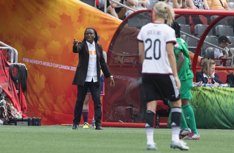 Ivory Coast coach Clementine Toure gives instructions to her players during a Group B match against Germany at the 2015 FIFA Women's World Cup at Landsdowne Stadium in Ottawa on June 7, 2015. (NICHOLAS KAMM/AFP/Getty Images)