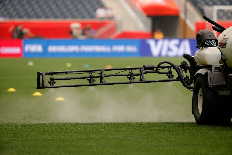 The pitch is sprayed down prior to the FIFA Women's World Cup Canada 2015 Group D match between Sweden and Nigeria at Winnipeg Stadium on June 8, 2015 in Winnipeg, Canada. (Photo by Kevin C. Cox/Getty Images)
