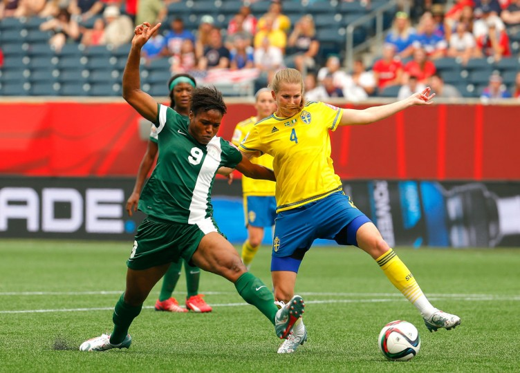 Desire Oparanozie of Nigeria challenges Emma Berglund of Sweden during the FIFA Women's World Cup Canada 2015 Group D match at Winnipeg Stadium on June 8, 2015 in Winnipeg, Canada. (Photo by Kevin C. Cox/Getty Images)