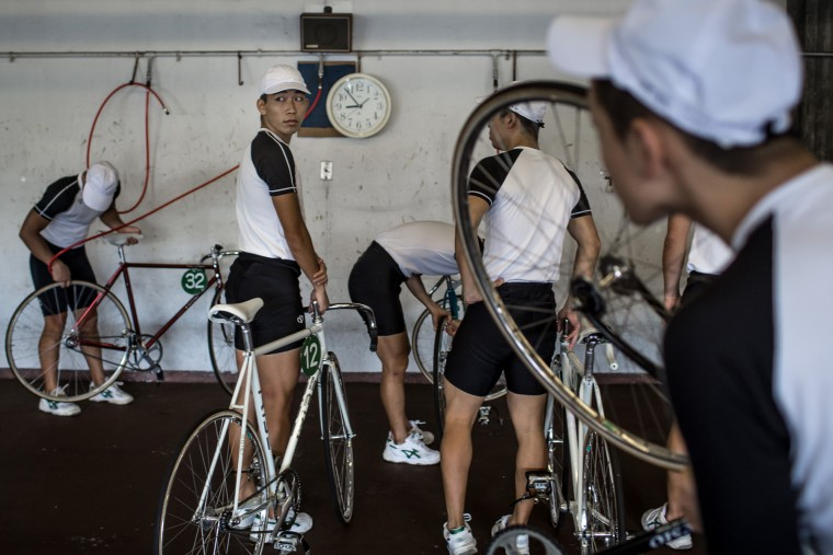 Keirin students line up to fill their tires with air ahead of training at the Nihon Keirin Gakkou (Japan Keirin School) on July 8, 2015 in Izu, Japan. (Photo by Chris McGrath/Getty Images)