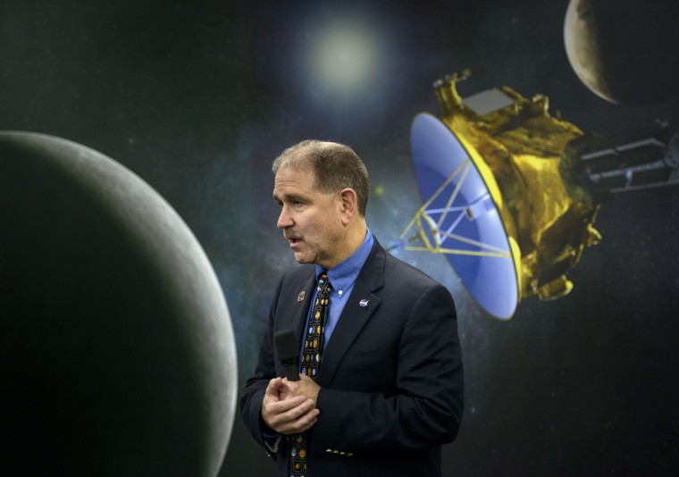 "John M. Grunsfeld, NASA Associate Administrator for the Science Mission Directorate, speaks at the Johns Hopkins University Applied Physics Laboratory July 14, 2015 in Laurel, Maryland.The unmanned NASA spacecraft whizzed by Pluto on July 14, making its closest approach in the climax of a decade-long journey to explore the dwarf planet for the first time, the US space agency said. Moving faster than any spacecraft ever built -- at a speed of about 30,800 miles per hour (49,570 kph) -- the flyby happened at 7:49 am (1149 GMT), with the probe running on auto-pilot. It was to pass by Pluto at a distance of 7,767 milesTelevision host Bill Nye the ""Science Guy,"" listens during a presentation at the Johns Hopkins University Applied Physics Laboratory July 14, 2015 in Laurel (AFP PHOTO/BRENDAN SMIALOWSKIBRENDAN SMIALOWSKI/AFP/Getty Images)"