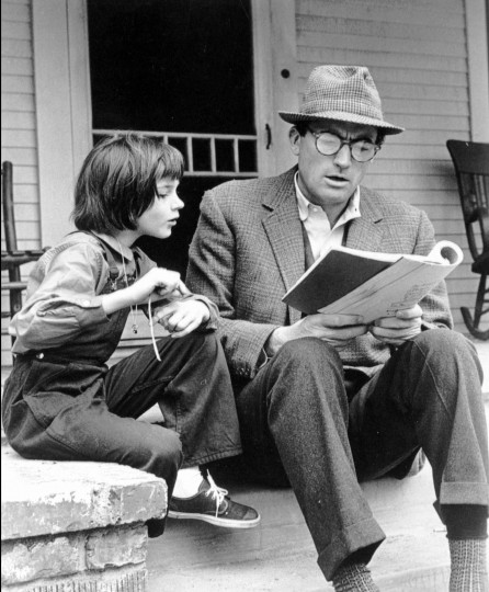 "July 11, 1960: Harper Lee's novel ""To Kill a Mockingbird"" is released. In 1962, it was made into a movie starring Gregory Peck, left, and 9-year-old Mary Badham, who are seen here studying their lines on the set in this file photo."