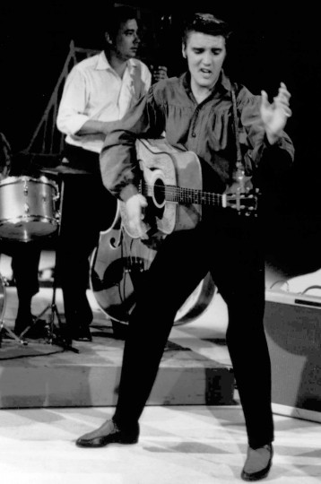 "July 7, 1954: Elvis Presley, seen here performing on the ""Ed Sullivan Show,"" debuted his song ""That's All Right"" on WHBQ radio in Memphis, Tenn. (AP file photo)"