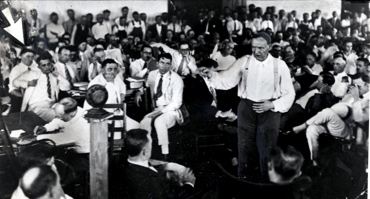 "July 10, 1925: The famed Scopes trial, or ""Monkey trial"" (officially The State of Tennessee v. John Thomas Scopes), began on this date. The trial surrounded a high school teacher, who was accused of breaking the law that evolution could not be taught in schools. In this file photo, coatless and pointing, Clarence Darrow argues for the acquittal of Scopes during. (File photo)"