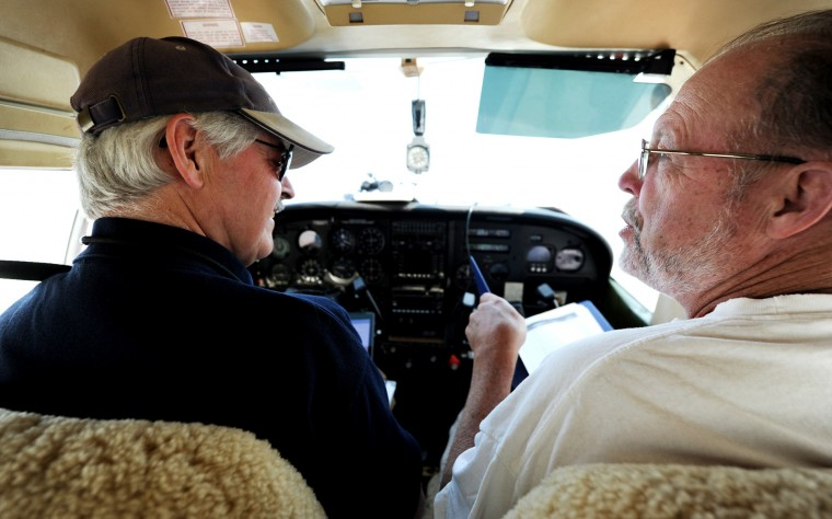Larry Esser, right, of Glen Burnie, is a long-time friend of Derward Brooks who often co-pilots with him during missions for Angel Flight East. The two are getting ready to set out in a single-engine Cessna plane, departing BWI Airport and headed for Philadelphia to pick up a patient and take her to Lynchburg, Va. on Wednesday, June 10, 2015. (Jon Sham/Baltimore Sun)