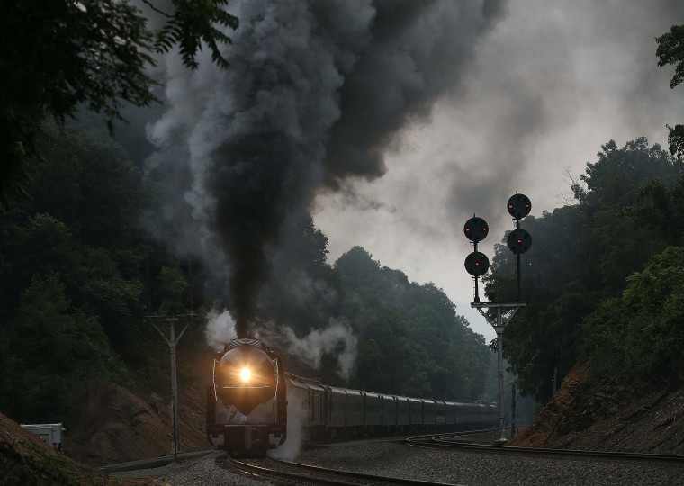 BLUE RIDGE, VA - JULY 03: The recently restored former Norfolk and Western Railway J class steam locomotive 611 passes by during an excursion July 3, 2015 in Blue Ridge, Virginia. The 611 was originally retired and replaced by diesel locomotives in 1959 and now is running excursions on a limited schedule. (Photo by Mark Wilson/Getty Images)