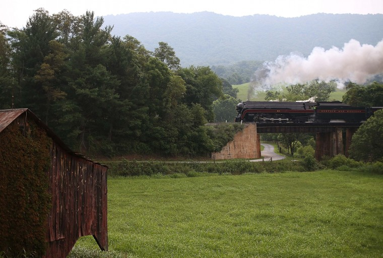 ROANOKE, VA - JULY 03: The recently restored former Norfolk and Western Railway J class steam locomotive 611 passes by during an excursion July 3, 2015 in Roanoke, Virginia. The 611 was originally retired and replaced by diesel locomotives in 1959 and now is running excursions on a limited schedule. (Photo by Mark Wilson/Getty Images)