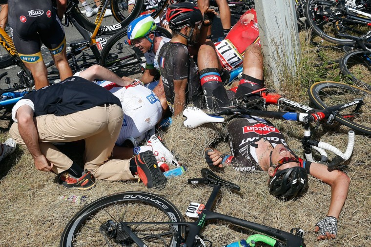 (L-R) William Bonnet of France riding for FDJ, Simon Gerrans of Australia riding for Orica-GreenEdge, Jose Mendes of Portugal riding for Bora-Argon 18, Greg Henderson of New Zealand riding for Lotto Soudal and Ramon Sinkeldam of the Netherlands riding for Giant-Alpecin lay on the ground after being involved in a crash with 65km remaining in stage three of the 2015 Tour de France from Anvers to Huy on July 6, 2015 in Huy, Belgium. (Photo by Doug Pensinger/Getty Images)