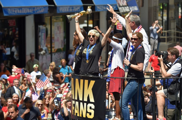 Soccer players Carli Lloyd and Megan Rapinoe, Chirlane McCray, Mayor Bill de Blasio and U.S. Coach Jill Ellis aboard a float in the New York City Ticker Tape Parade for World Cup Champions U.S. Women's Soccer National Team on July 10, 2015 in New York City. (Photo by Michael Loccisano/Getty Images)