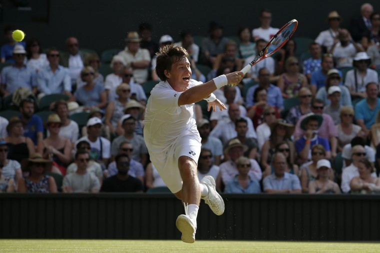 Lithuania's Ricardas Berankis leaps for a return against Croatia's Marin Cilic but misses the ball during their men's singles second round match on day three of the 2015 Wimbledon Championships at The All England Tennis Club in Wimbledon, southwest London, on July 1, 2015. (ADRIAN DENNIS/AFP/Getty Images)