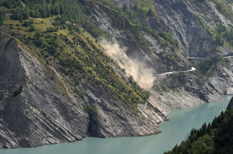 A picture taken on July 5, 2015 shows a landslide above the Chambon lake and the Chambon tunnel, on the road linking Grenoble to Briançon, by the Lautaret pass in Mont-de-Lans, near the French ski resort Les Deux Alpes, in eastern France. The road has been closed since April 10 due to tunnel damage and a risk of major landslide. The organisers of the Tour de France had to change the 20th stage of this year's race to L'Alpe dHuez as it was not possible to climb the Col du Telegraphe and the Galibier. (Philippe Desmazes/AFP/Getty Images)