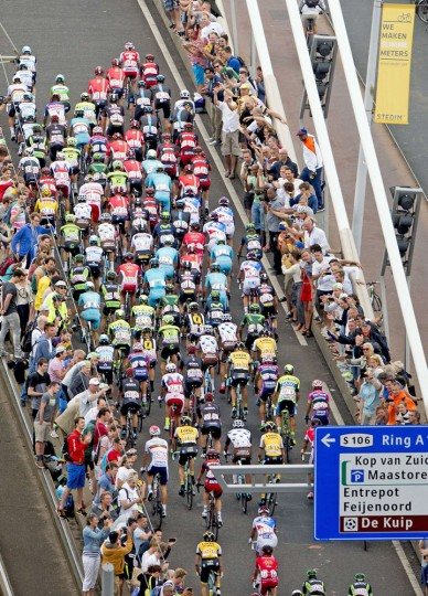 The pack rides on the Erasmusbrug (Erasmus bridge) in Rotterdam, during the 166 km second stage of the 102nd edition of the Tour de France cycling race on July 5, 2015, between Utrecht and Neeltje Jans island, in Zeeland province, The Netherlands. (Robin Utrecht/AFP/Getty Images)