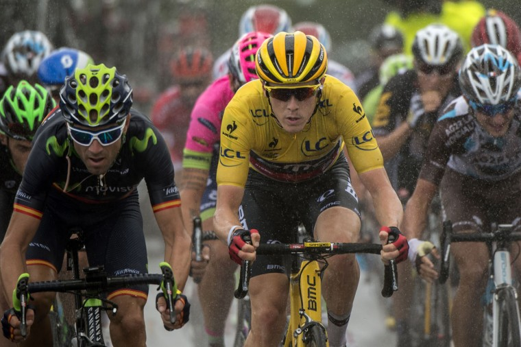 Spain's Alejandro Valverde (L) and Australia's Rohan Dennis, wearing the overall leader's yellow jersey, ride in the pack during the 166 km second stage of the 102nd edition of the Tour de France cycling race on July 5, 2015, between Utrecht and Vrouwenpolder in Zeeland province, The Netherlands. (Lionel Bonaventure/AFP/Getty Images)