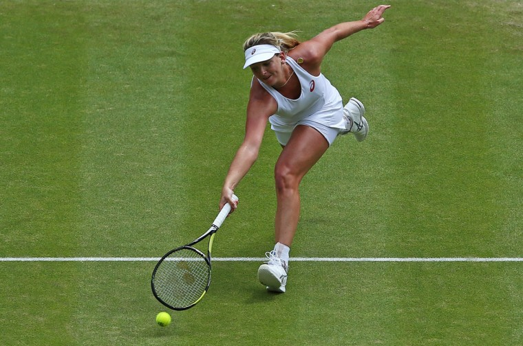 U.S. player Coco Vandeweghe stretches to return to Russia's Maria Sharapova during their women's quarterfinals match on day eight of the 2015 Wimbledon Championships at The All England Tennis Club in Wimbledon, southwest London, on July 7, 2015. (JUSTIN TALLIS/AFP/Getty Images)